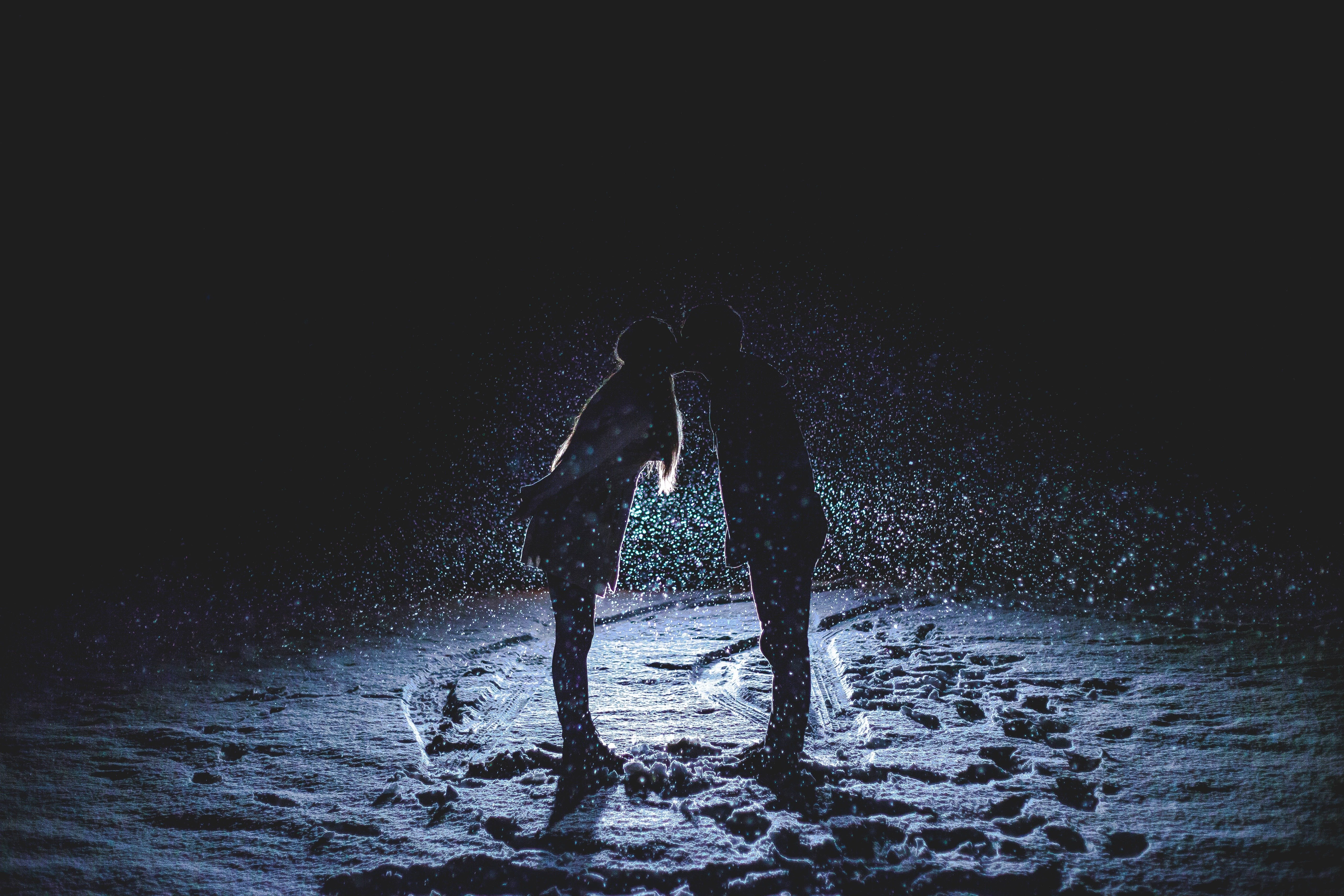 Couple Kissing and Connecting in Snow